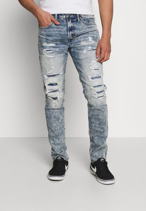 SLIM - Jeans Tapered Fit - destroyed medium wash