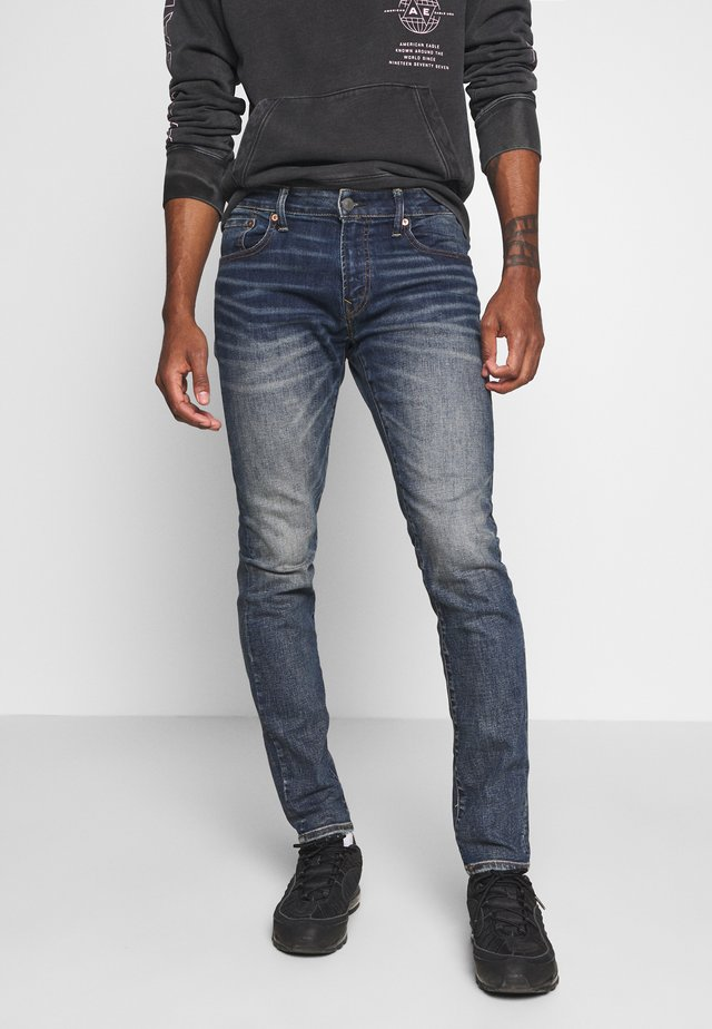 SLIM TAPER - Jeans Tapered Fit - dark indigo