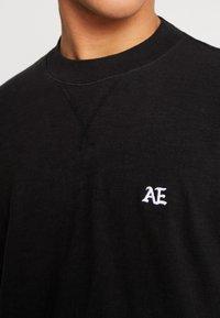 American Eagle - MOCK NECK PANEL - Maglietta a manica lunga - bold black/medium grey - 5