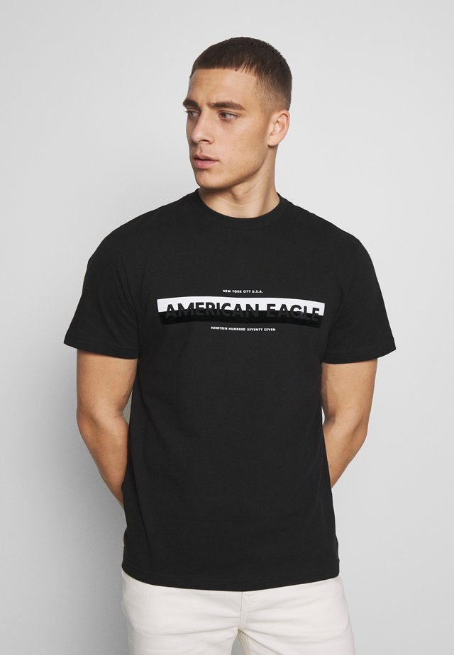 BOUND NECK TEE - Print T-shirt - black