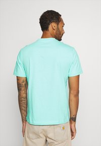 American Eagle - UNISEX SET IN TEE CORE BRAND - T-shirt z nadrukiem - cream mint - 2