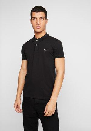 SLIM FIT FLEX - Polo shirt - black