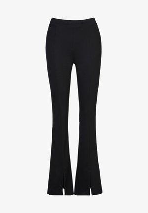 CAROLA - Trousers - black
