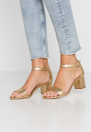 LEATHER HEELED SANDALS - Sandales - gold