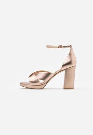 High heeled sandals - rose gold