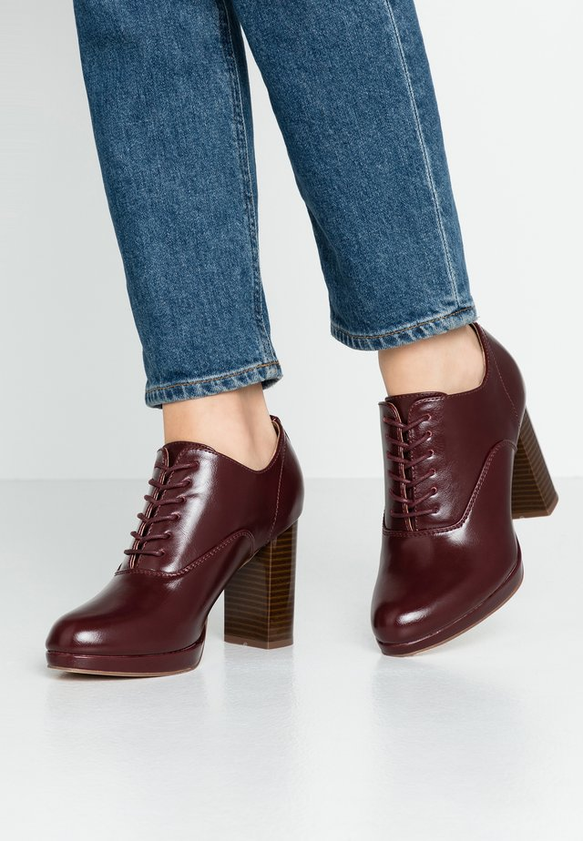 High heeled ankle boots - berry