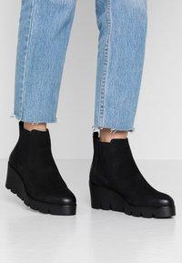 Anna Field - Kotníkové boty na klínu - black - 0
