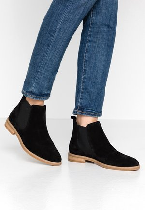 LEATHER BOOTIES - Korte laarzen - black