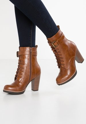 High heeled ankle boots - cognac