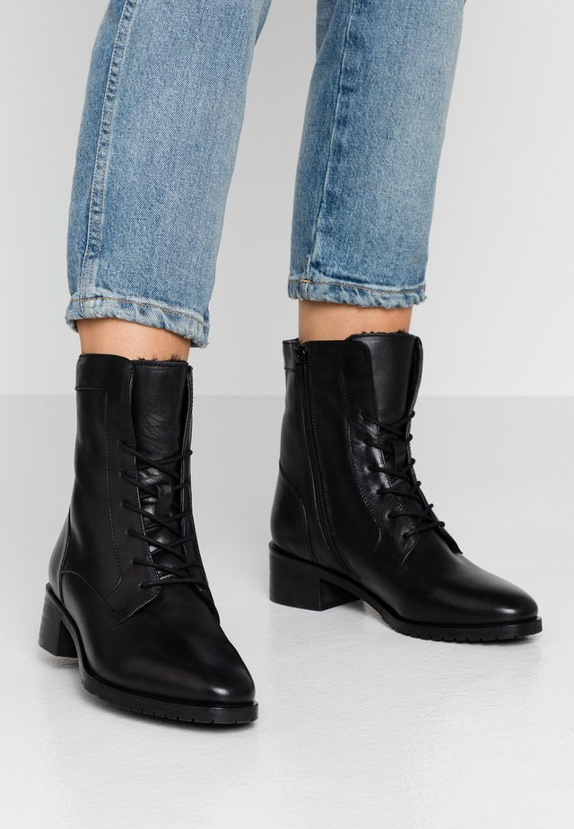 LEATHER WINTER BOOTIES - Lace-up ankle boots - black