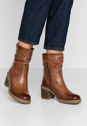 LEATHER WINTER BOOTIES - Botas para la nieve - brown