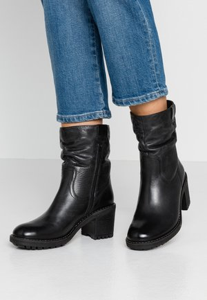 LEATHER WINTER BOOTIES - Snowboots  - black