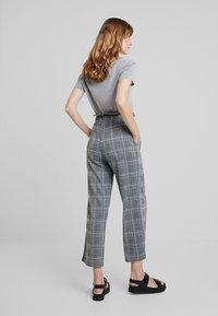 Anna Field - Spodnie materiałowe - black/white - 3