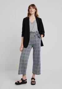 Anna Field - Spodnie materiałowe - black/white - 2