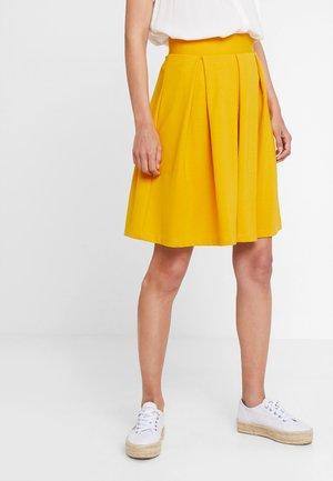 Áčková sukně - golden yellow