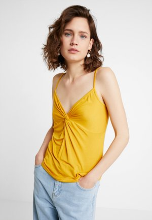 Topper - golden yellow