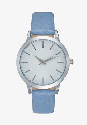Horloge - light blue