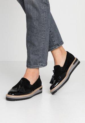 LEATHER SLIP-ONS - Slippers - black