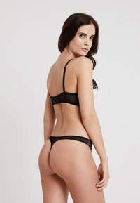 Ann Summers - AVAH THONG - Stringit - nude/black - 2