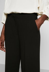 Another-Label - MOORE PANTS - Kalhoty - black - 4