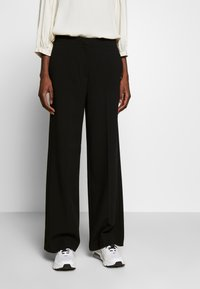 Another-Label - MOORE PANTS - Kalhoty - black - 0