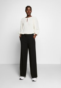 Another-Label - MOORE PANTS - Kalhoty - black - 1
