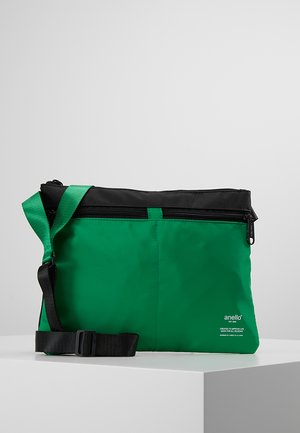 SLIM CROSS BODY - Umhängetasche - green/black