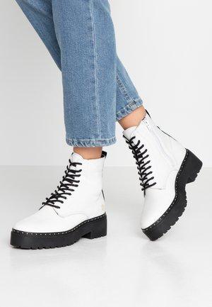 BALI - Platform ankle boots - white/black