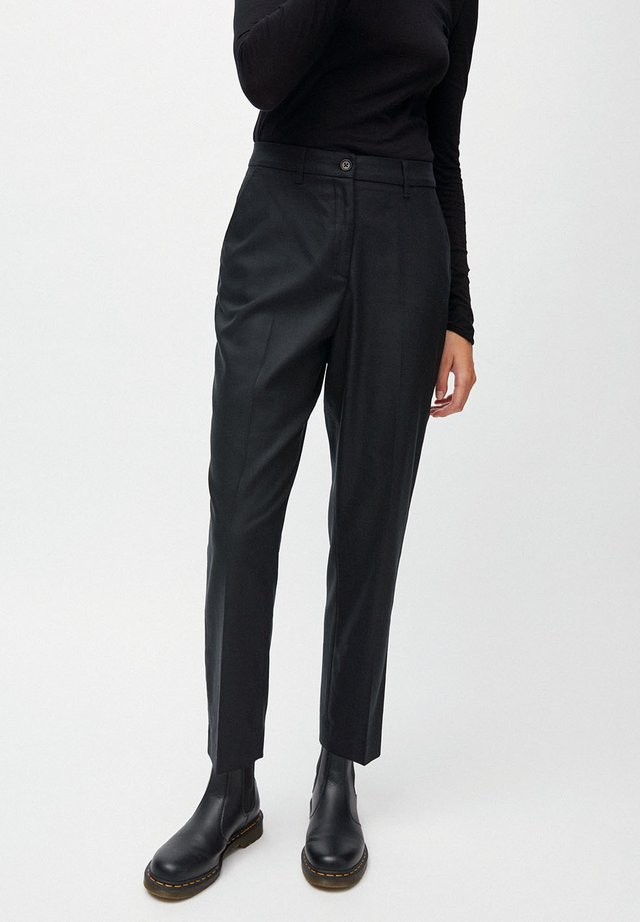 HERTTAA - Trousers - black