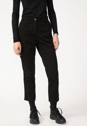 VESTAA - Trousers - black