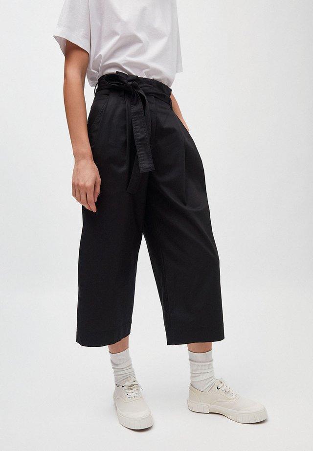 VIOLETTAA - Trousers - black