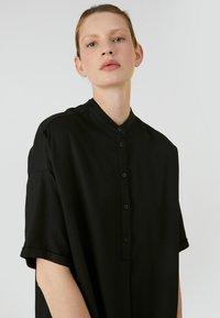 ARMEDANGELS - MAARJULI - Shirt dress - black - 2