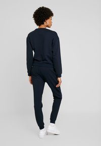 Armani Exchange - TROUSER - Tracksuit bottoms - navy - 2