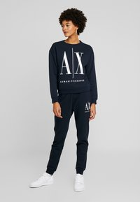 Armani Exchange - TROUSER - Tracksuit bottoms - navy - 1