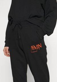 Armani Exchange - JOGGERS - Trainingsbroek - black - 4