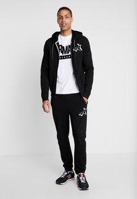 Armani Exchange - Pantalon de survêtement - black - 1
