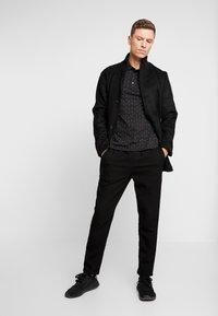 Armani Exchange - Polo shirt - black - 1