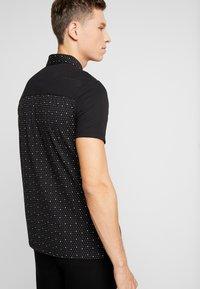 Armani Exchange - Polo shirt - black - 2