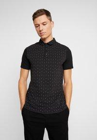 Armani Exchange - Polo shirt - black - 0