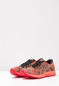 ASICS - GEL-DS TRAINER 24 - Zapatillas de running neutras - sun coral - 2