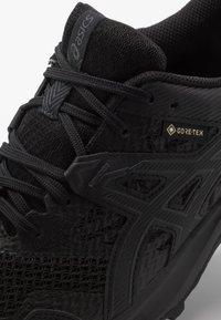 ASICS - GEL-SONOMA 5 G-TX - Trail running shoes - black - 5
