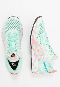 ASICS - GEL-NOOSA TRI 12 - Competition running shoes - fresh ice/guava - 1