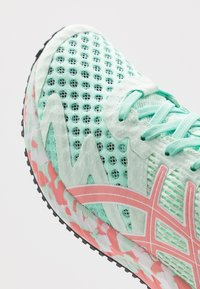 ASICS - GEL-NOOSA TRI 12 - Competition running shoes - fresh ice/guava - 6