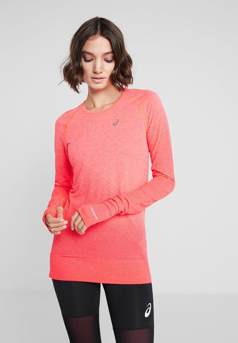 ASICS - SEAMLESS TEXTURE - T-shirt de sport - laser pink