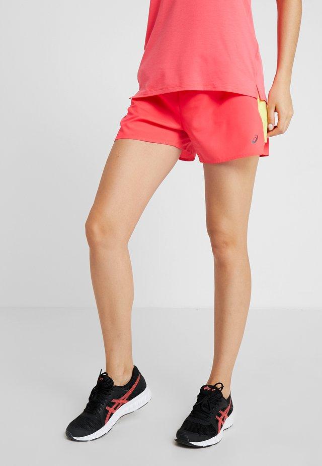 Pantalón corto de deporte - laser pink/sour yuzu