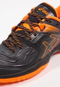 ASICS - BLAST FF - Volleyballschuh - black/shocking orange - 5