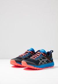 ASICS - FUJILYTE XT - Trail running shoes - electric blue/black - 2
