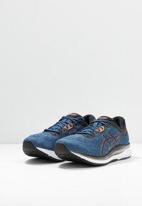 ASICS - EVORIDE - Neutral running shoes - grand shark/pure bronze - 2