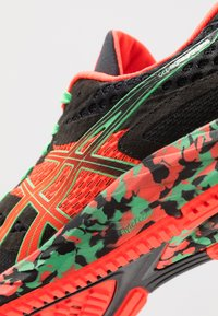 ASICS - GEL-NOOSA TRI 12 - Competition running shoes - black/flash coral - 6
