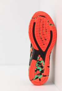 ASICS - GEL-NOOSA TRI 12 - Competition running shoes - black/flash coral - 4
